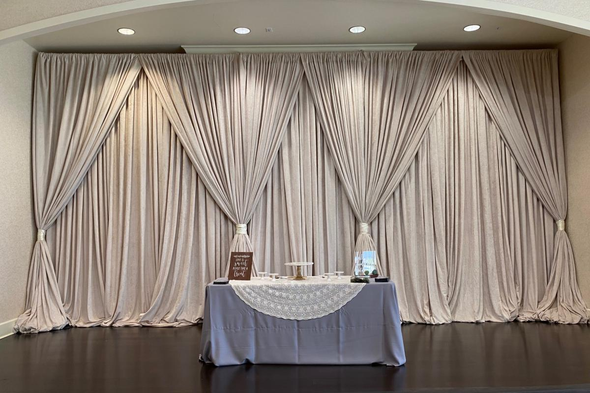 Grand Ballroom stage with draping and sweet heart table