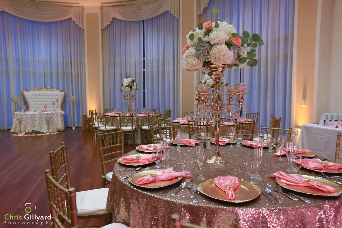 Reception in Rotunda with table settings and floral arrangement