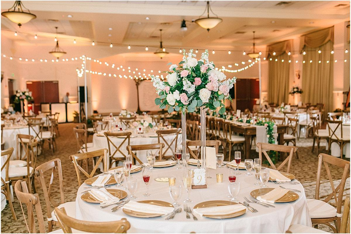 Reception in grand ballroom with tables set and market lighting