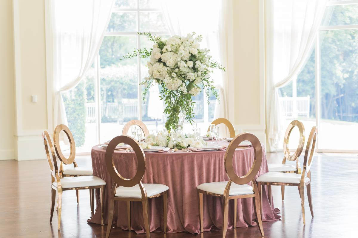 Reception table in Rotunda with center piece and gold chairs