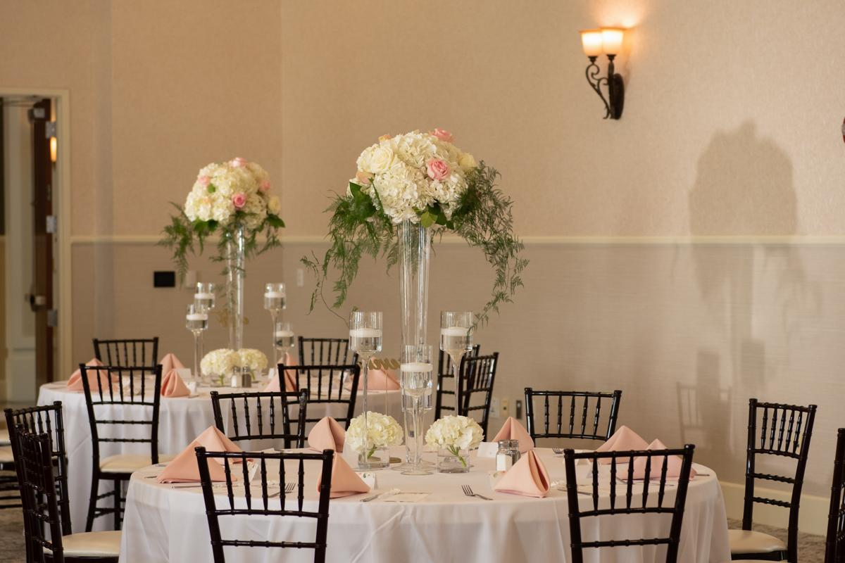 Table in Grand Ballroom with chiavari chairs and floral centerpiece