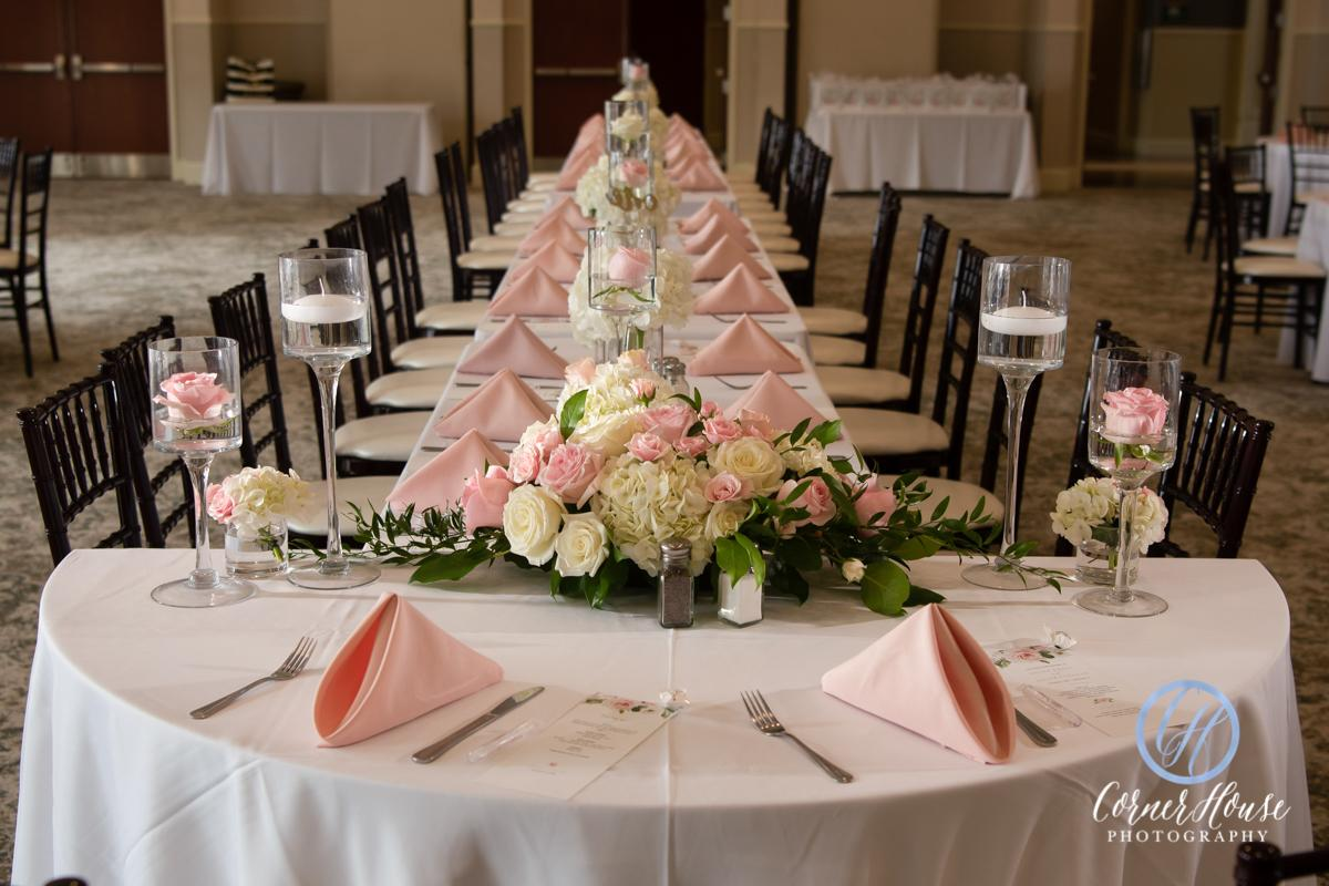 Head table in Grand Ballroom with floral centerpieces