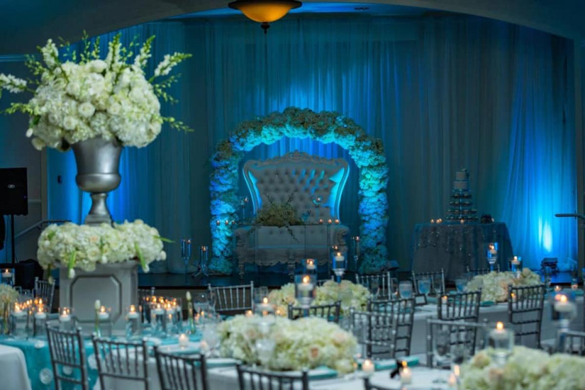 Grand Ballroom with floral arch and rented high back couch
