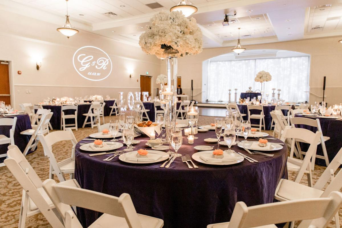 Reception in Grand Ballroom with white folding chairs