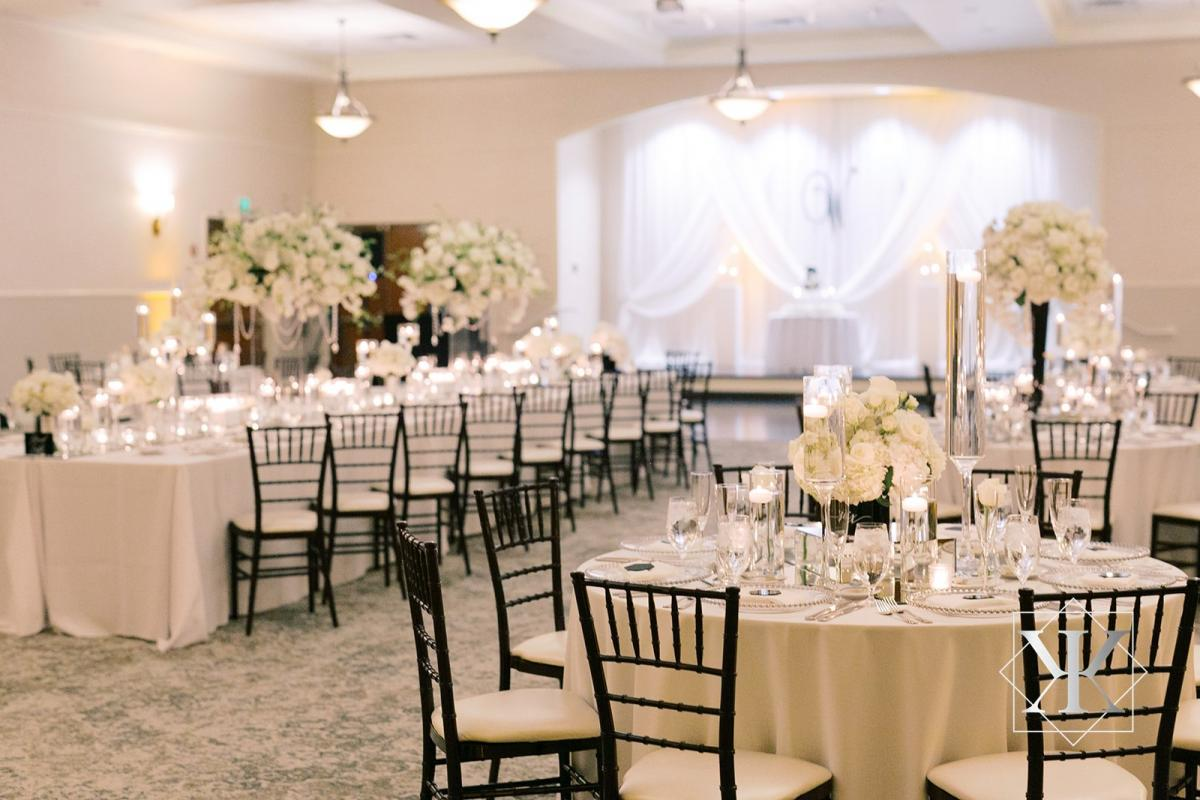 Reception in grand ballroom with chiavari chairs and draping