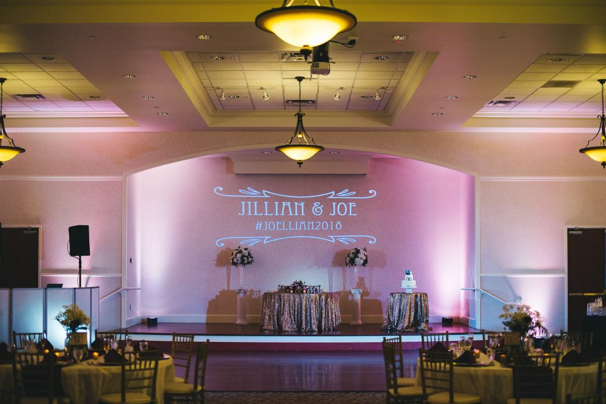 Stage and dance in Grand Ballroom with monogram and sweetheart table